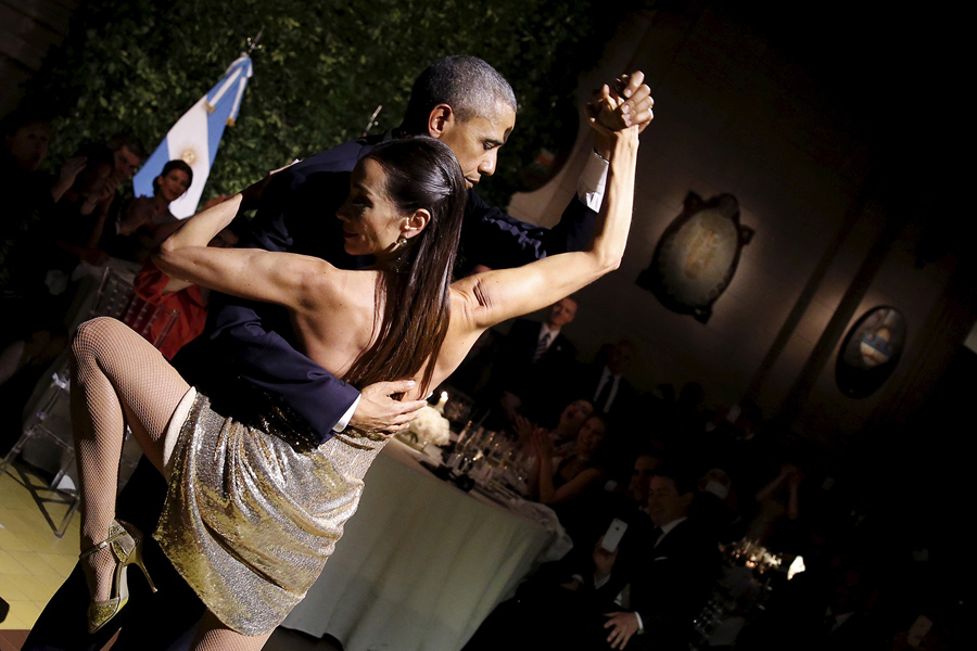 U.S. President Barack Obama dances tango during a state dinner hosted by Argentina's President Mauricio Macri at the Centro Cultural Kirchner as part of President Obama's two-day visit to Argentina, in Buenos Aires March 23, 2016. REUTERS/Carlos Barria TPX IMAGES OF THE DAY - RTSBZHY